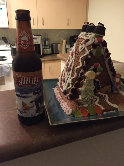 A holiday beer next to a holiday artifact.