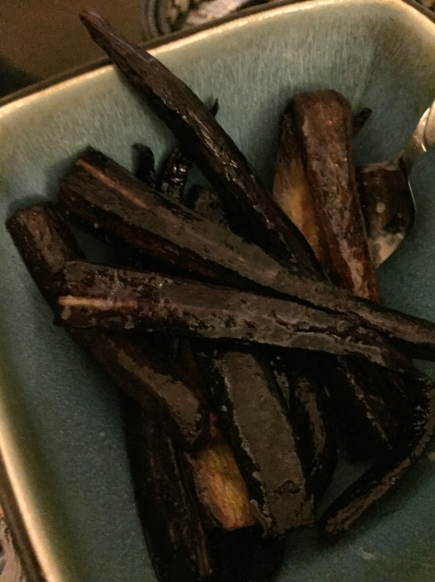 Roasted purple carrots that look like witch fingers.