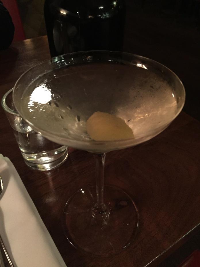 A martini in very unwieldy martini glass.