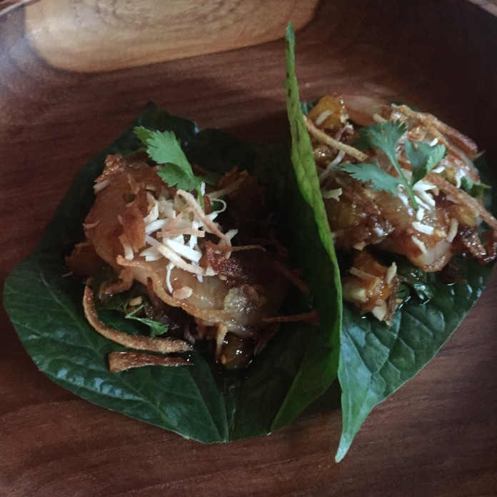 Heirloom navel orange, shrimp, shallot, chili, lime, ginger in roasted coconut sauce, betel leaf